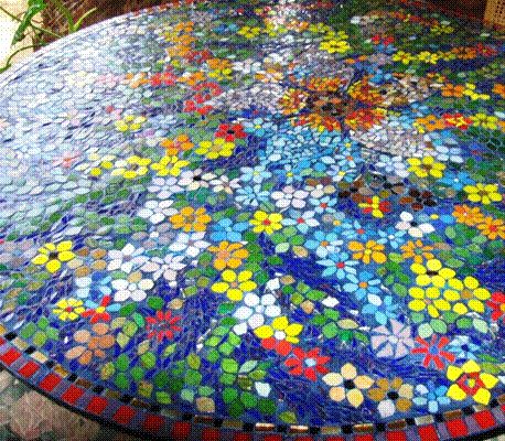 a really unique mosaic design with glass tile on an outdoor table - Mosaic Design Ideas