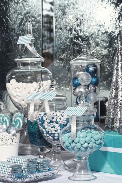Keep your holiday party on-theme with this blue & white candy table. We love it.