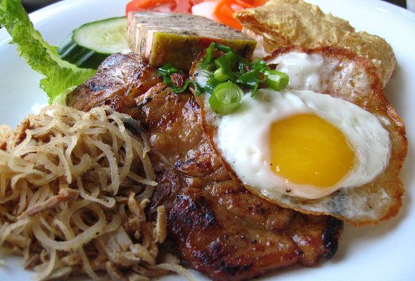 Com Tam is a breakfast dish that is broken rice served with an assortment of side-dishes such as meatloaf, shredded pork, pickled veggies (typically radish and carrot), grilled pork and fried egg. Although it sounds like a heavy dish, given the portions are minute this dish is surprisingly satisfying in the tropical weather of Vietnam.  This dish originates from Southern Vietnam.