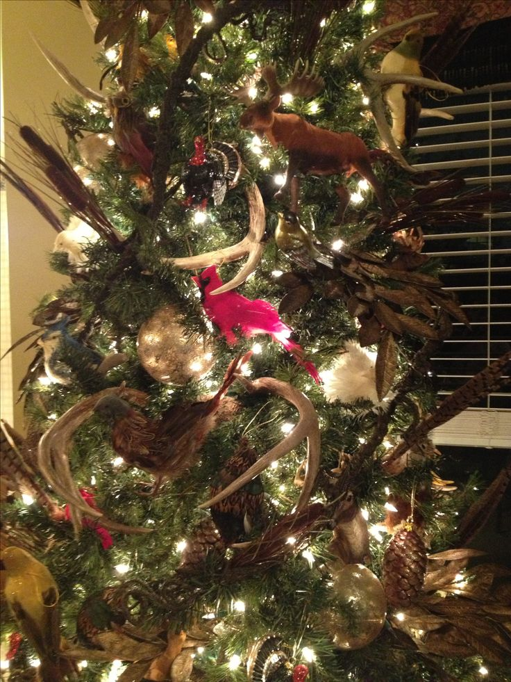 Our Christmas Tree With A Wildlife Theme And Antlers With