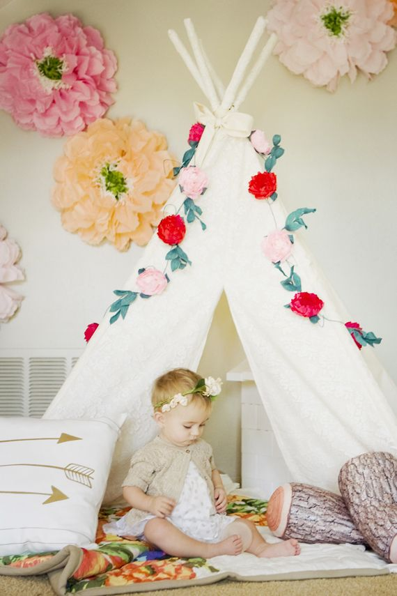 how to style girls teepee for play room...love the color and flowers on the wall with gold arrow pillow