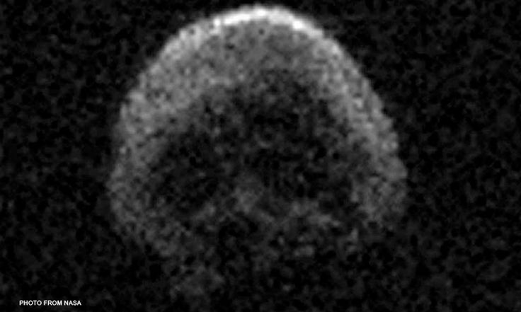 "A large space rock resembling a skull narrowly missed Earth shortly after 1 p.m. ET Saturday (October 31). NASA says asteroid 2015 TB145 is a ""dead"" comet that once spewed debris across the solar system. In NASA terminology, that means it has ""shed its volatiles"" that would produce the visible tail seen on some comets."