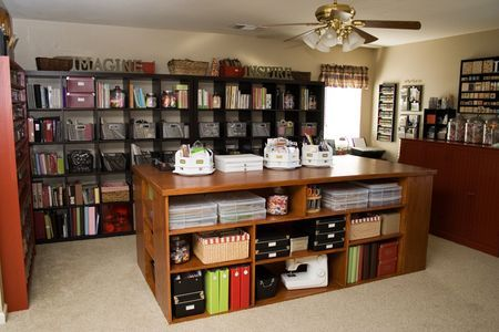 This is one of the coolest ways to organize a craft room I've ever seen. It's also a little insane, but super easy to see what you have, which is a must for me. Check out her site for more pics and to see her cool paint and button shelves!