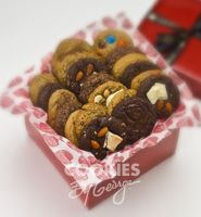 Large George Box — 36 gourmet cookies gift wrapped in a shiny red box with ribbon and a gift tag.