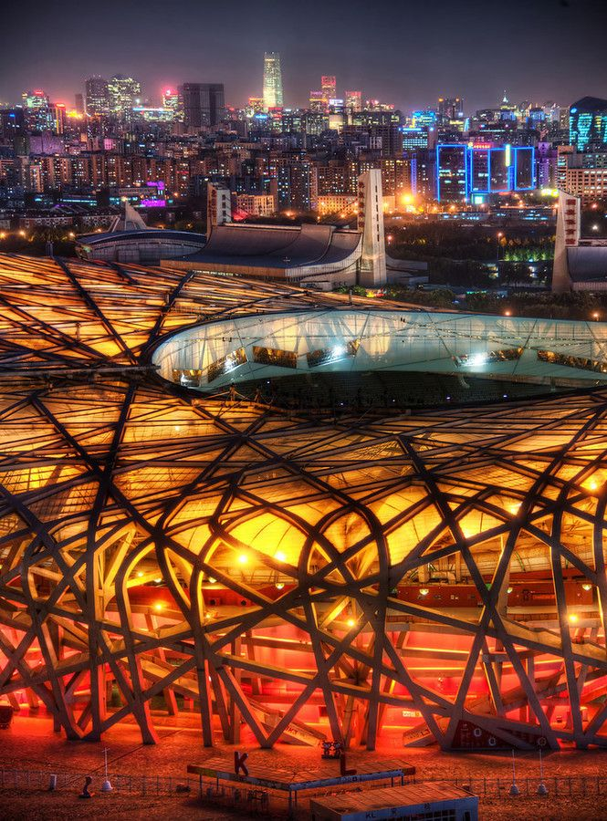 The nest looks cool against all the layers of the city for The nest beijing