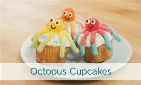 Octopus Cupcakes How-To video.  Pretty simple - gummy worms, gum drops, vanilla and chocolate frosting, blue gel and white nonpareils.
