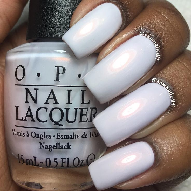 "Opi ""Oh My Majesty!"" on dark skin. Pearl white nail polish on dark skin. Nail polish on dark skin."