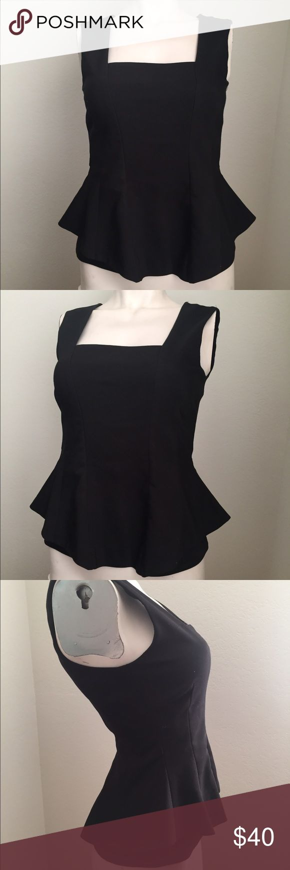 Zara peplum top Gorgeous black peplum top by Zara. Hugs and accentuates curves. Invisible zipper down the back. Perfect for a date night! Zara Tops