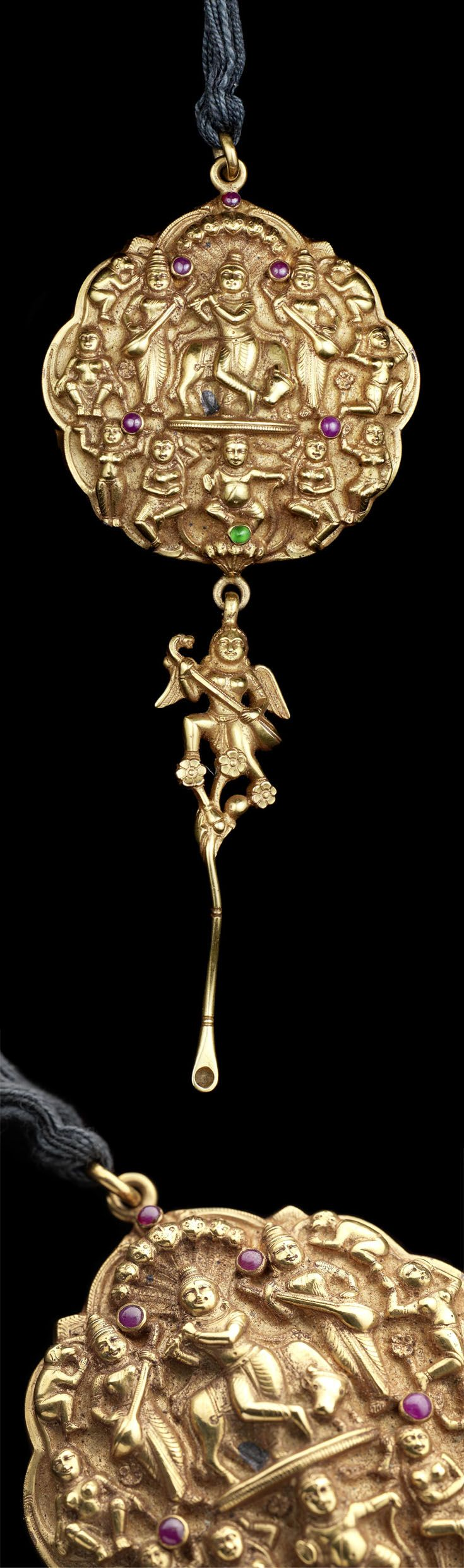 South India   Gold pendant set with emerald and ruby; depicting Krishna playing the flute, with an ear-spoon suspension and peri-peri below   19th century   Est. 5'000 - 7'000£ ~ Occt '13