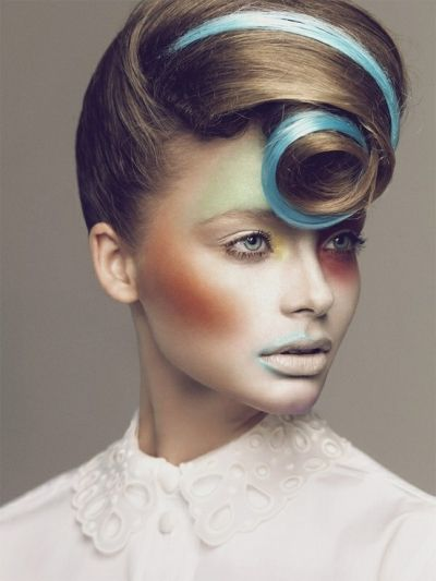 avant garde hairstyles | Avant-garde hairstyle with blue highlights and curly fringe