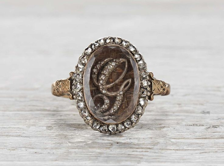 "Vintage Victorian mourning ring made in 18k yellow gold. Accented with rose cut diamonds and a diamond encrusted ""G"" encased within a locked featuring braided hair. Engraved George J. Hone, Born 24 Nov, Died... Circa 1882."