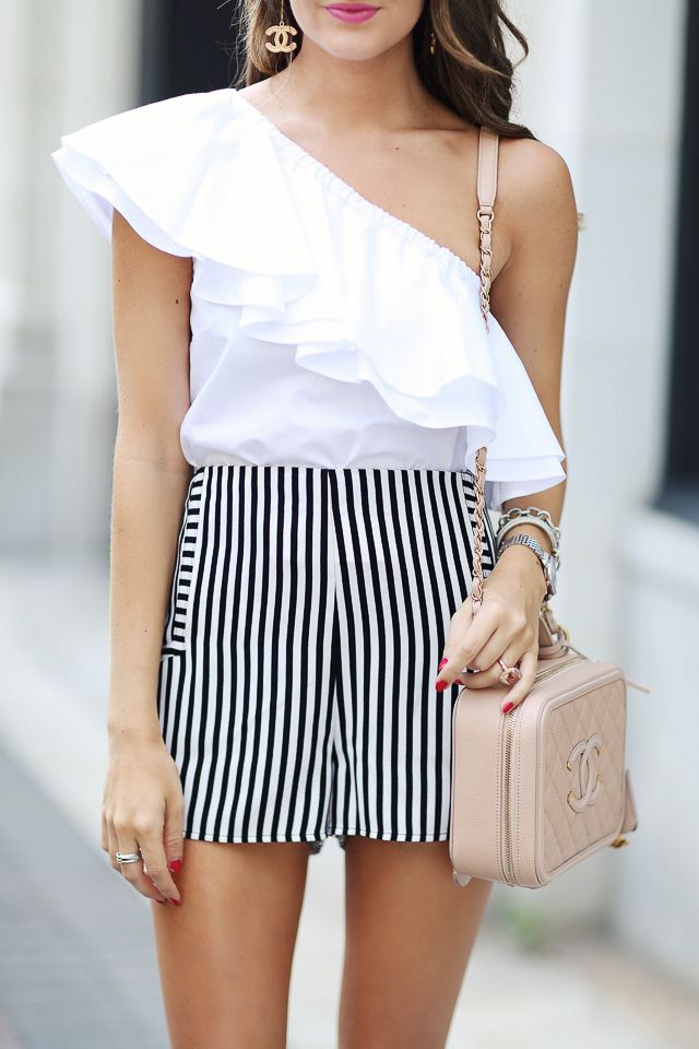 off shoulder ruffle top + vertical striped shorts + Chanel vanity case in beige