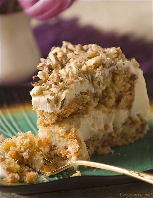 Old-Fashioned Carrot Cake with Vanilla Cream Cheese Frosting - Moist layers with a nuance of pineapple and spice, nestled in a creamy, tangy frosting and showered with crunchy toasted walnuts - carrot cake at its best. carrot cake