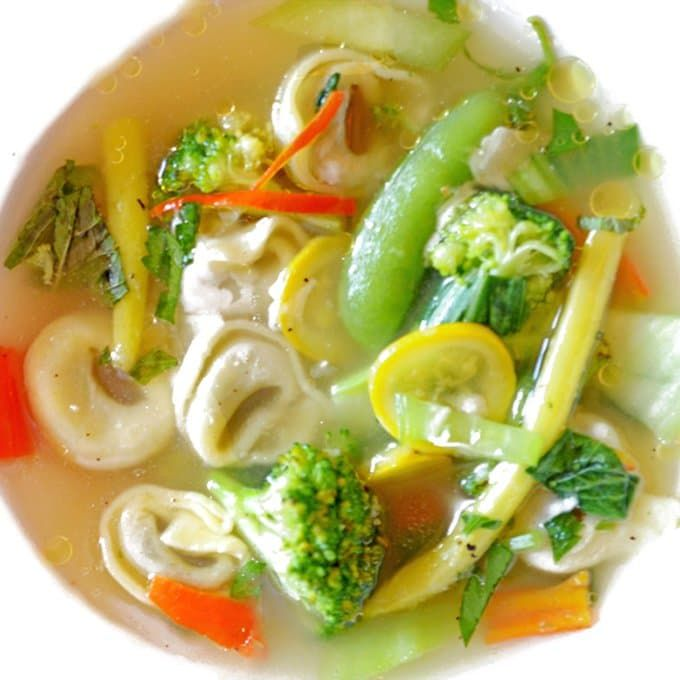 Tortellini in brodo d'estiva (broth of summer) features fresh summer produce and herbs quickly prepared in a savory broth. Fast and delicious.