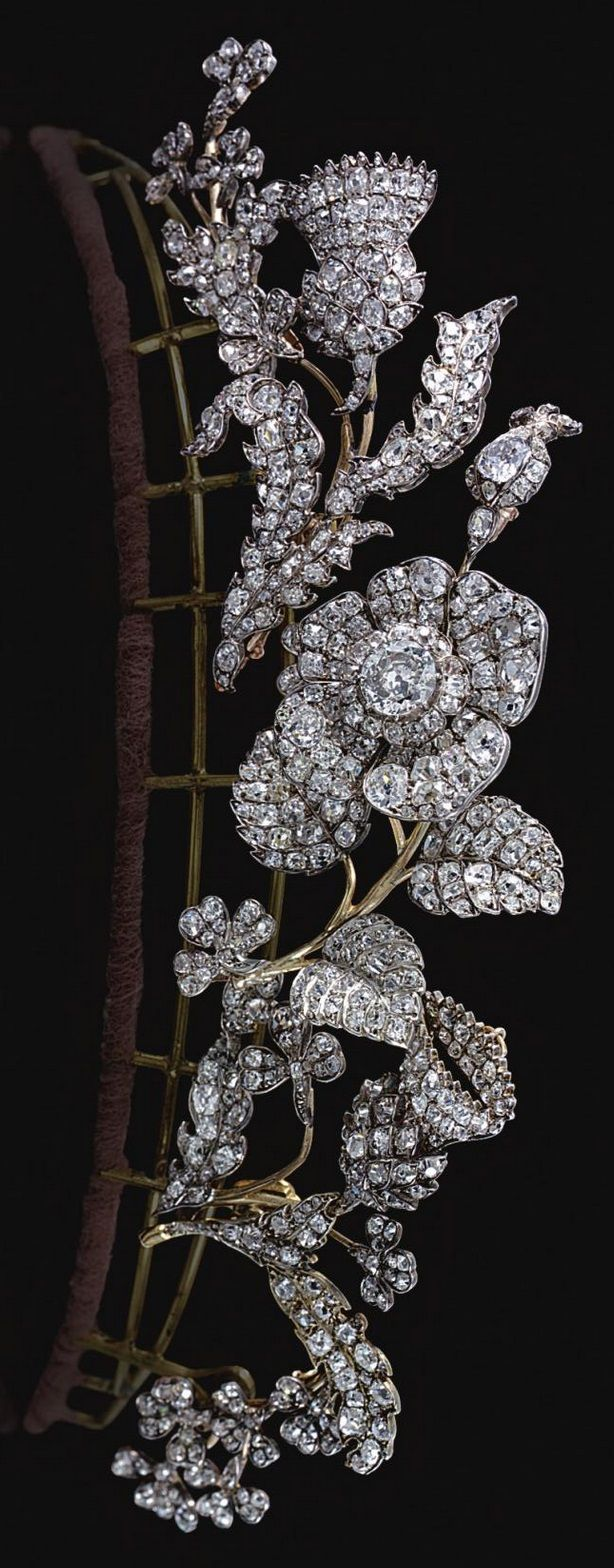 A Georgian antique diamond tiara/corsage ornament, early 19th Century. Designed as five foliate sprays, each symbolising one of the three Kingdoms of the United Kingdom of Great Britain, centring on a single rose flower head set en tremblant, emblematic of England, flanked with the thistle and shamrock, symbolising the Kingdoms of Scotland and Ireland, set with old-mine, circular-cut and cushion-shaped diamonds.