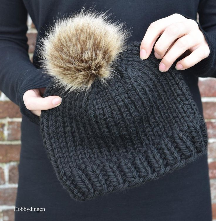 Make your own beautiful pompom hat with this pattern! Find this pattern and more knitting inspiration at LoveKnitting.Com.