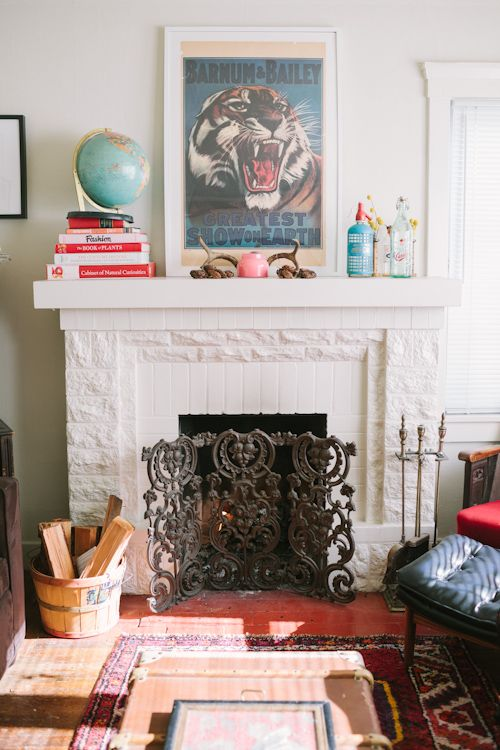 Love the vintage circus print on this fireplace mantel