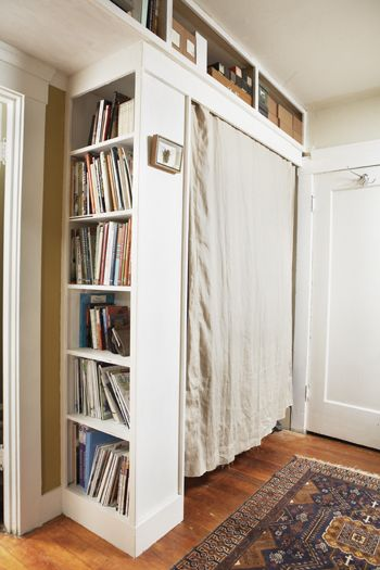 Pinner says: Using a small bookshelf turned outward and a curtain, why not create a closet in a nook or behind a door? Making sure to anchor the bookcase to the wall for stability, you could mount a hanging rod across the allotted space and disguise it with a curtain. If the bookcase is not sturdy enough to attach the hanging rack to, simply add a wall-mounted rod, like this one from Improvements.
