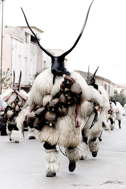 Sardinia, Italy ~ Nuoro is the town where the character of Mamuthone reenacts ancient pre-Christian rites of propitiation to the ancient gods of agriculture. The mask is carved in pieces of wild pear wood, alder  walnut  darkened.  The mask has become iconic of rural Sardinia.