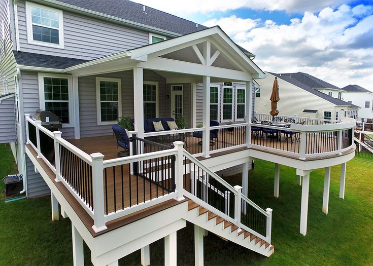 This custom deck & porch combo was designed and built to create more usable living space for the homeowner. Pull up a chair at the custom curved bar top or escape from the weather under a lovely A frame porch. Features such as a custom lighting package, gable end detail in the porch & 5' wide steps help to