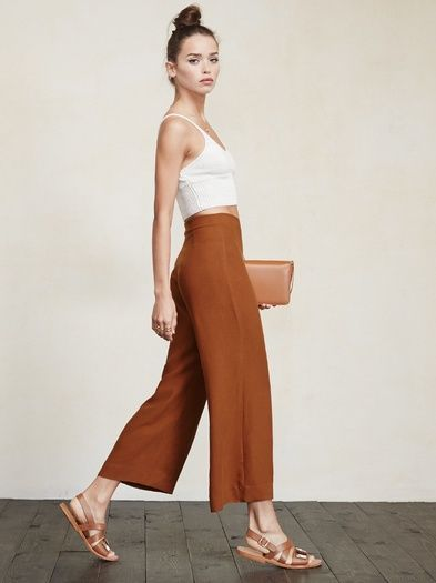 Free the ankle. The Becca Pant is perfect for any occasion and any season. Literally all of your tops will look good with it. This is a crepe, wide-leg pant that we cropped just right for you. It's got a high waist and a hook/zip closure at the side.  Made from surplus rayon blend.