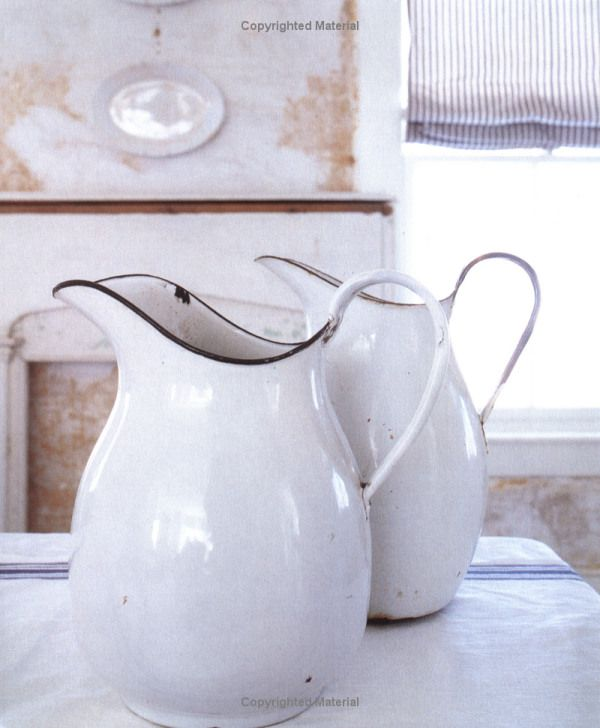 vintage enamel jugs ~ THIS is what I want for my kitchen utensils! Or maybe use as a vase for flowers and use at centerpiece for the kitchen table
