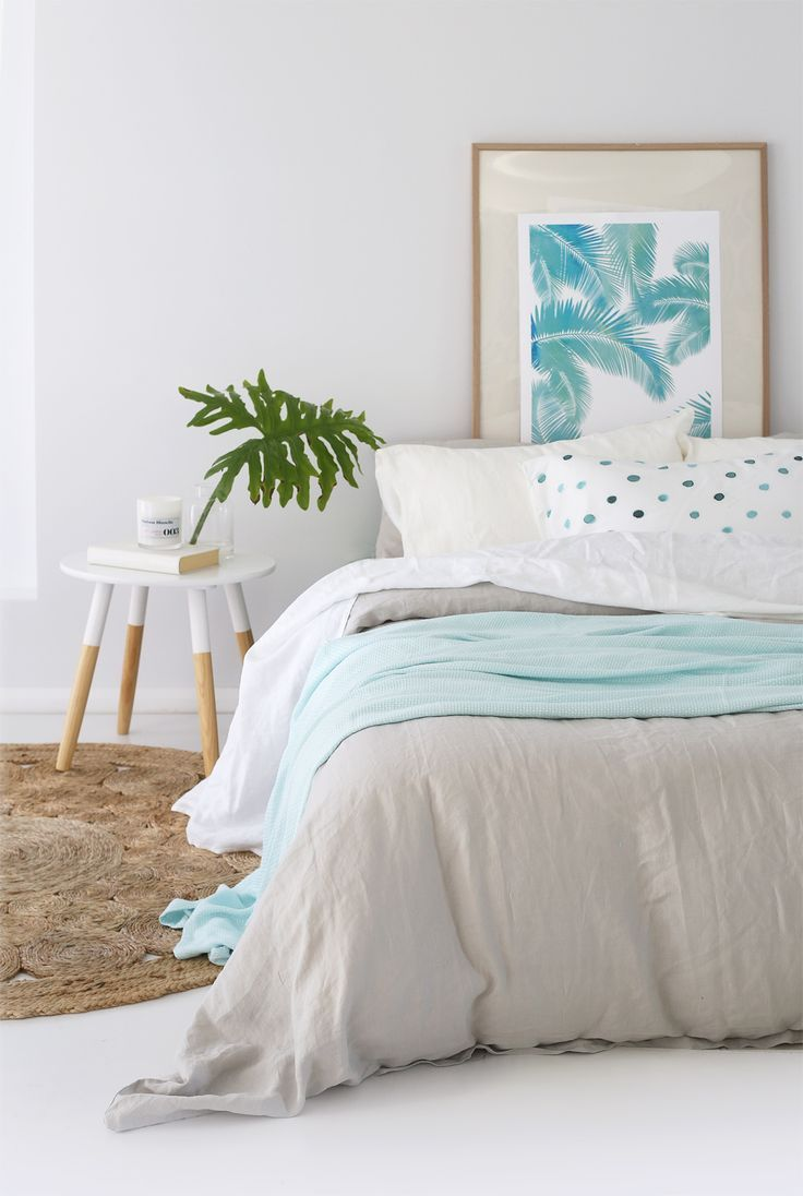 neutral contemporary style bedroom with patel blue and tropical leaf print