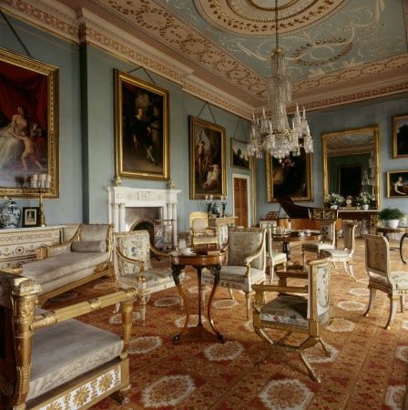 The Drawing Room at Attingham Park near Shrewsbury, Shropshire, England, with pale blue painted walls and Adam style ceiling. White and gold Italian furniture in the Empire style. Fireplace designed by J. Deval the Younger in 1785.