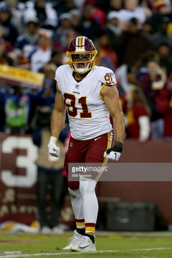 6b61ebc0c03 Ryan Kerrigan of the Washington Redskins reacts after a play against ...