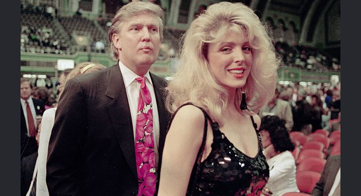 Donald Trump and then-girlfriend Marla Maples are seen at the Holyfield-Foreman boxing match at Trump Plaza in Atlantic City, April 19, 1991. AP