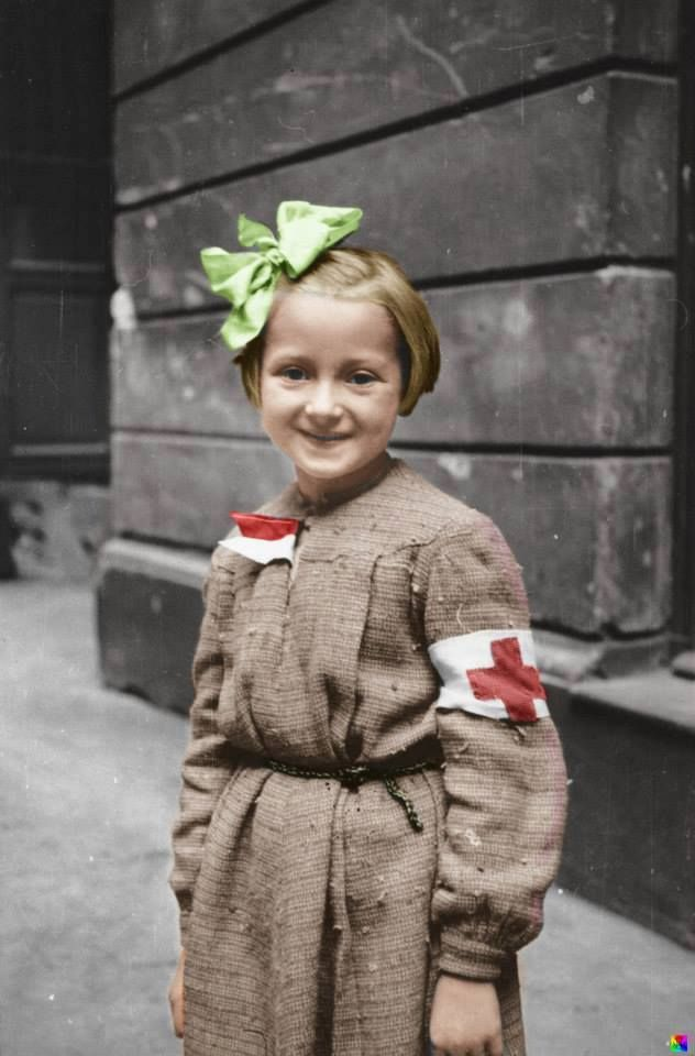 FANTASTIC PICTURE !!! Young girl acting as a nurse during the Warsaw Uprising, 1944. Great work by John Winner.