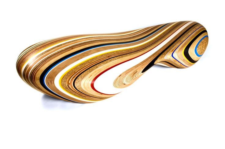 Remix, chiase longue, Brodie Neill Ltd   An organic shaped chaise lounge CNC carved from a random mix of reclaimed and sourced materials. The multicoloured pin stripe pattern includes plastics as well as a range of man-made wood products.
