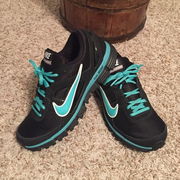 Nike Dual Fusion ST Like new Nike Dual Fusion shoes   Worn only a couple times. Have great support and low backs that don't dig into your heals. Nike Shoes Athletic Shoes