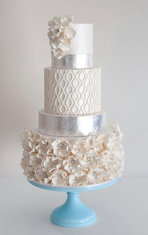 "Silver and white wedding cake. Follow us @SIGNATUREBRIDE on Twitter and on FACEBOOK @ SIGNATURE BRIDE MAGAZINE 2nd from top - the ""fretwork"" effect, but I'd prefer it to be simpler, not ridged..."