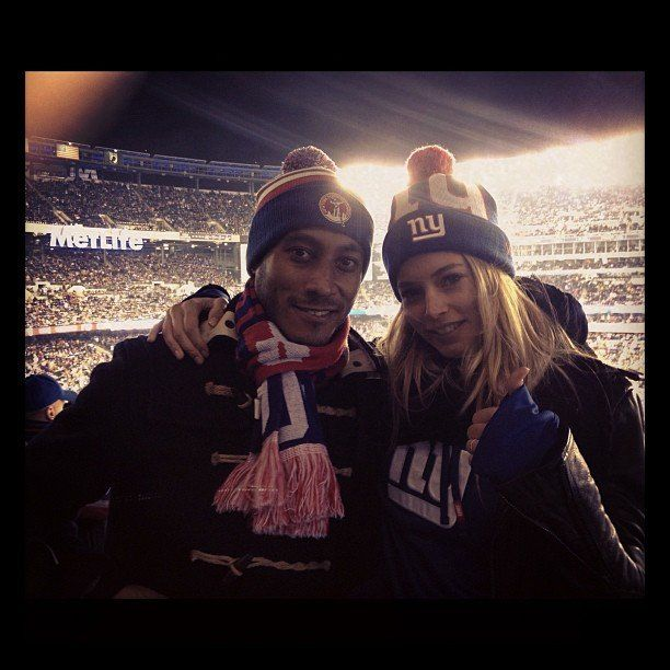 Model Doutzen Kroes  and her husband catch a NY Giants game.
