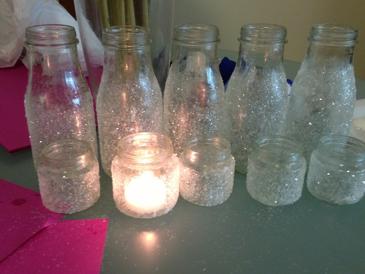starbucks and baby food jars clean them . take off the lables and paint mod podge and sprinkle white glitter. its a very easy diy project. you can use the baby jars for the candles and the starbuck jars as vases for flowers!