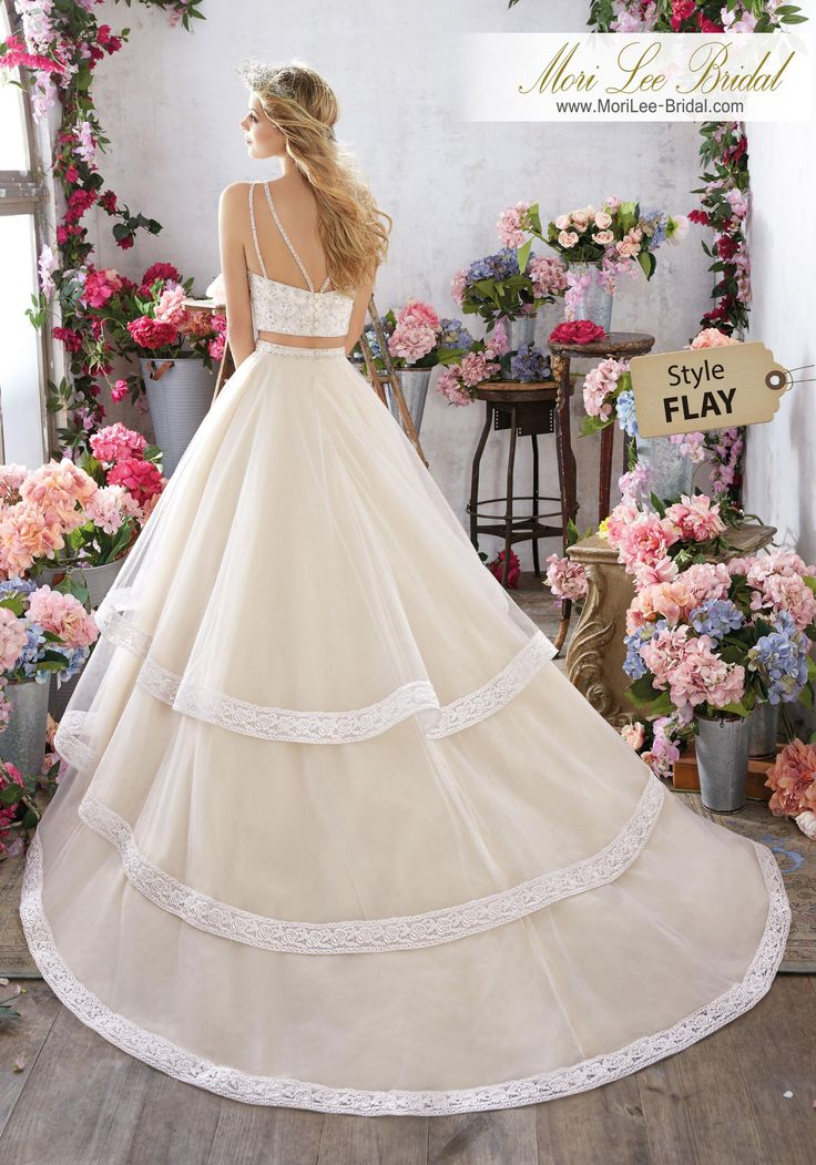 Style FLAY Meredith Wedding Dress  Fun and Flirty, This Two-Piece Gown Features a Crystal Beaded Bodice and Tiered Tulle Skirt with Exquisite Lace Edging. Double Strap Detail Accents the Back. Colors Available: White, Ivory, Light Gold. Shown in Light Gold.