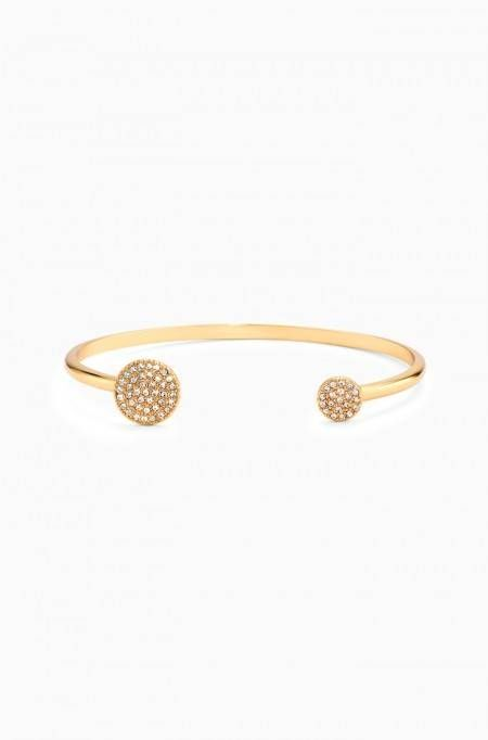 The perfect layering bracelet, the Pave Disc Cuff in Gold has just the right amount of sparkle. Shop gold pave cuff bracelets at Stella & Dot.