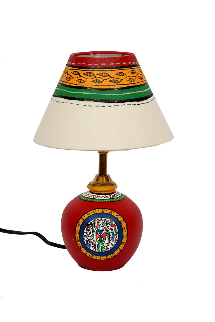 This unique terracotta round matki lamp has been beautifully handpainted to add the requried mood to the room. The shade has also been handpainted keeping in mind the color coordination with the earthen lamp.
