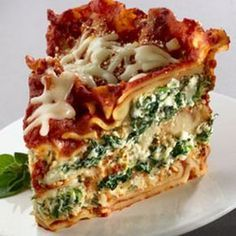Slow Cooker Spinach Lasagna Recipe Main Dishes with ricotta cheese, shredded mozzarella cheese, grated parmesan cheese, eggs, frozen chopped spinach, lipton recip secret veget soup mix, pasta sauce, lasagna noodles