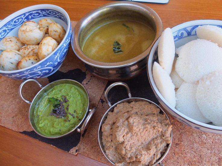 "Weekend brunch: Idlis and Kuzhipaniyarams with a coriander-green chilli chutney coconut-tamarind chutney and ""hotel"" sambhar :) #MangiaBene #TalesFromNW #HomeMade"