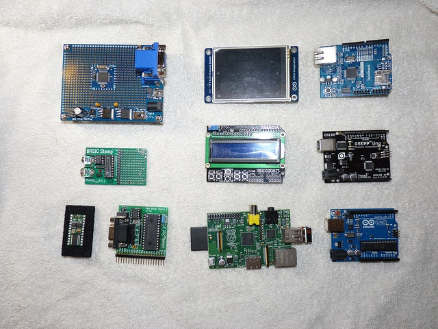 "Microcontroller size comparison:    Top row left to right:    Parallax Propeller, 3.2"" TFT Arduino Shield, Arduino Ethernet Shield    Middle row:    Parallax Basic Stamp, Arduino LCD Shield, OSEPP Arduino Uno    Bottom row:    Basic Stamp 2, Basic Stamp, Raspberry Pi, Arduino Uno    P1010458.JPG by prdamrcn, via Flickr"
