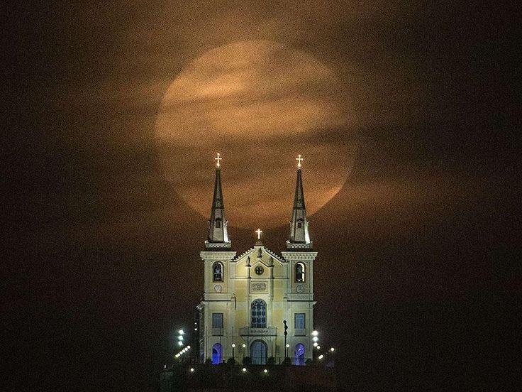 The Super Moon hovers over the Nossa Senhora da Penha Church in Rio de Janeiro, Brazil, on August 10, 2014.