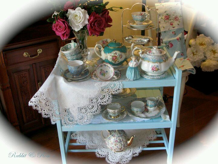 Little Cottage tea trolley laden with lace and pretty pastel vintage China....anyone for tea?...