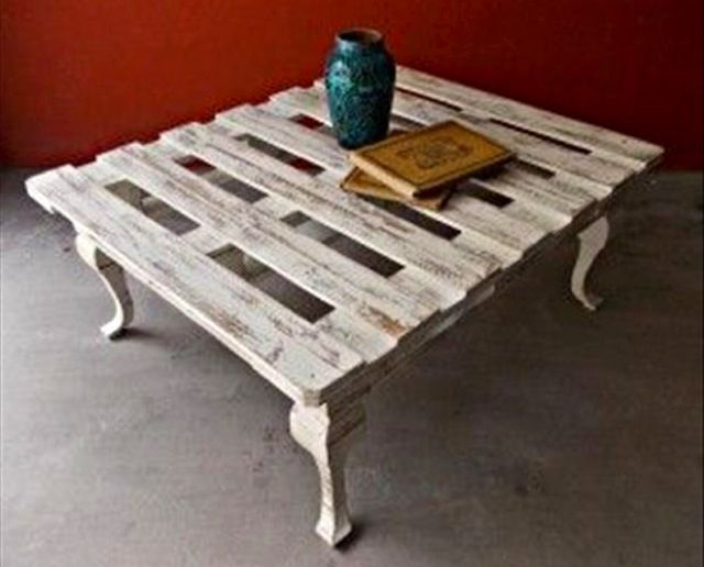 A full pallet is used for this coffee table. Adding Queen Anne legs and painting and distressing it all gives it a more upscale look.