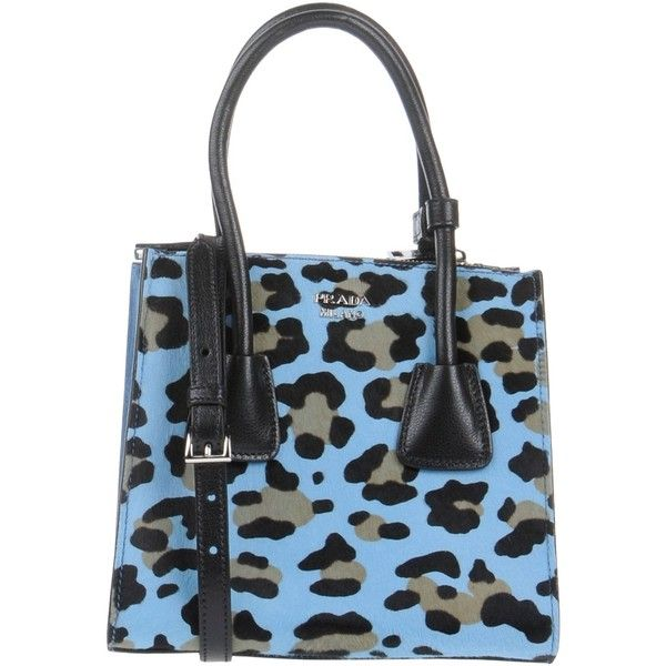 Prada Handbag ($1,270) ❤ liked on Polyvore featuring bags, handbags, sky blue, prada purses, zipper handbags, zip purse, prada handbags and animal handbags