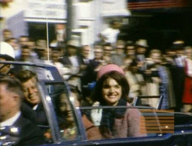 A home movie still captures first lady Jacqueline Kennedy, with President John F. Kennedy and Texas first lady Nellie Connally, just a few blocks from Dealey Plaza and only about 90 seconds before the assassination.