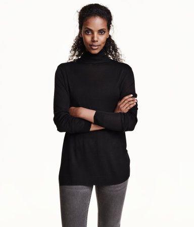 Long-sleeved, fine-knit turtleneck sweater with slits at hem.