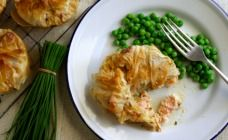 Here's a twist on an old-fashioned fish pie. The creamy sauce is rich and…