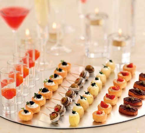 awesome hors d'oeuvres display... spray paint the back of a small glass table topper with mirror or chrome spray paint for a glamorous serving platter
